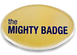Gold oval Mighty Badge