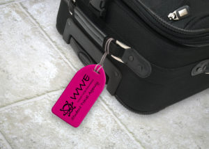 Pink neon luggage tag in use